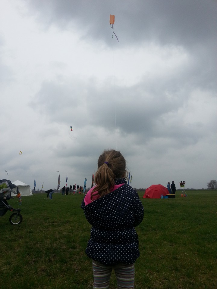 Child flying handmade kite at 2015 Kite Komotion kite festival in Shipshewana Indiana