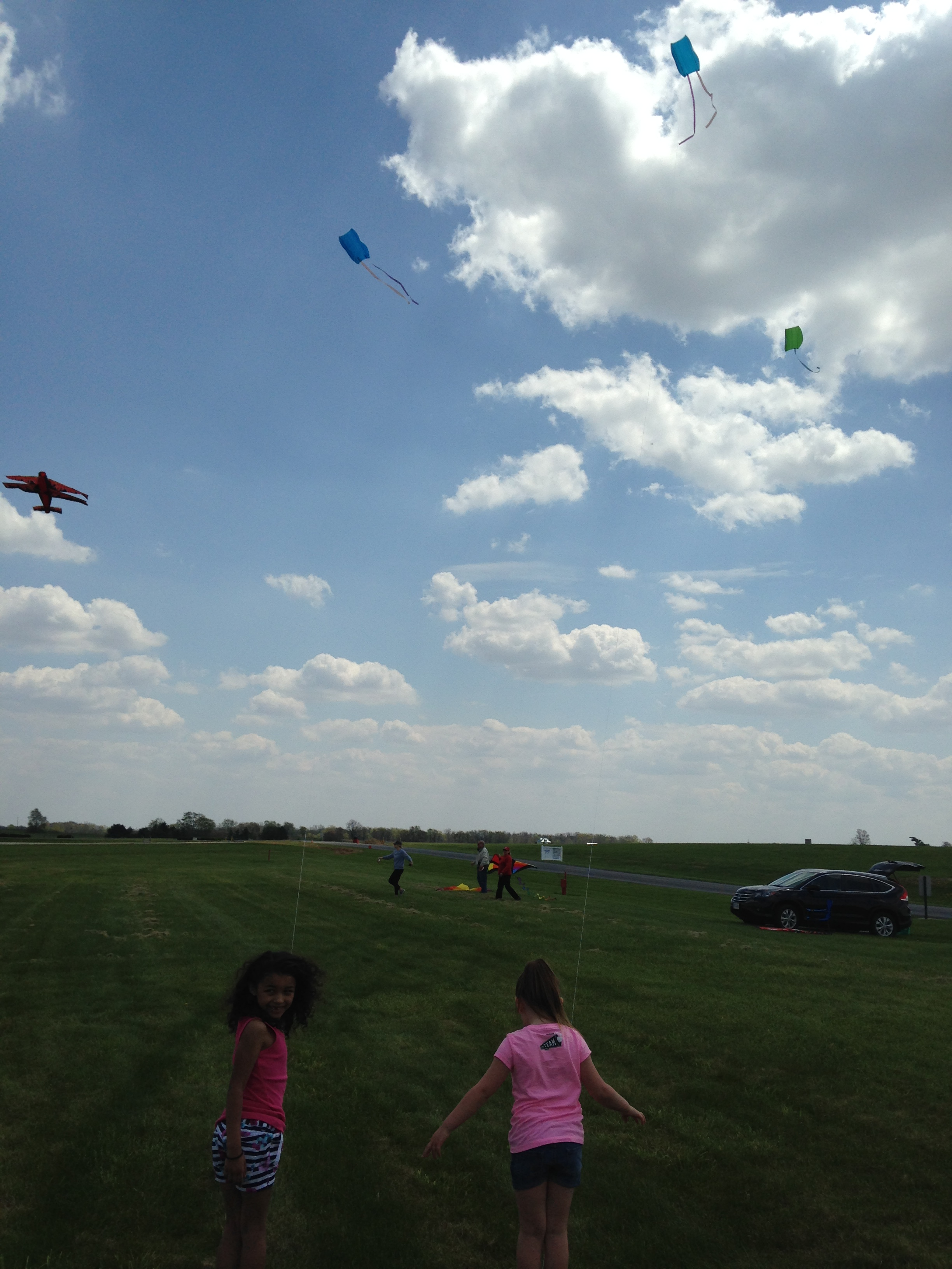Children fly kites at the Hoosier Kitefliers Society annual Ansel Toney Memorial Kite Fly, Muncie Indiana, May, 2015